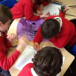 School children from Ysgol Bod Alaw making recycling posters