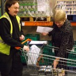 Baroness Randerson helps with the deliveries